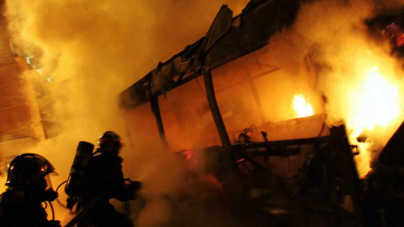 Masked perpetrators set bus on fire in Paris suburb