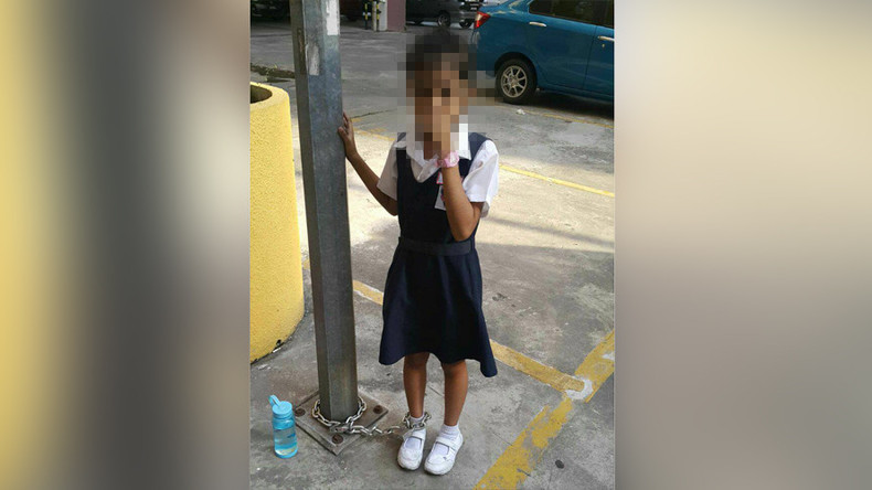 Mother chains daughter to a pole for refusing to go to school (PHOTOS)