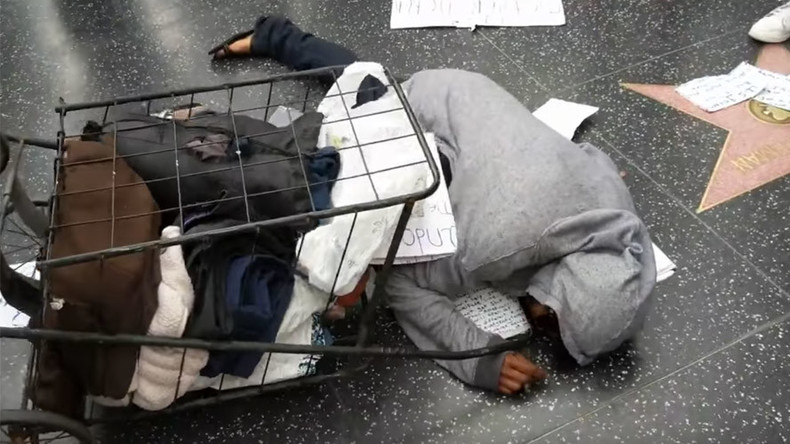 Violent crowd attacks, insults homeless woman guarding Trump's Hollywood star (VIDEOS)