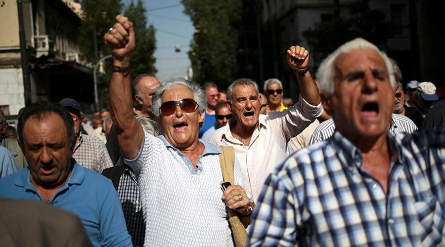 Greek pensioners rock police bus at Athens protest, tear-gassed in return (PHOTOS, VIDEOS)