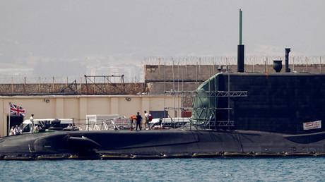 A man leaves the British nuclear Astute-class submarine HMS Ambush © Jon Nazca