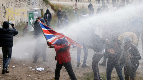 French police use water canon to disperse demonstrators who hold a march near the