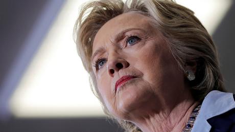 'Clinton campaign blames Russian hackers as Assange promises more leaks'