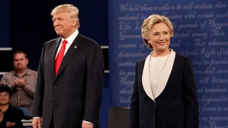 Republican U.S. presidential nominee Donald Trump and Democratic U.S. presidential nominee Hillary Clinton appear together during their presidential town hall debate at Washington University in St. Louis, Missouri, U.S., October 9, 2016. © Mike Segar