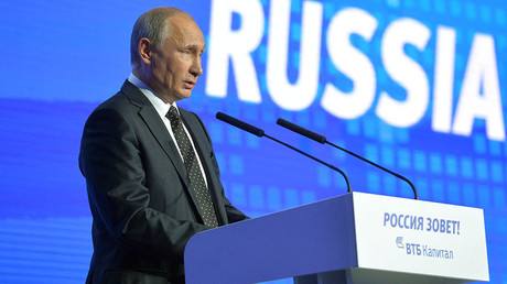 Russian President Vladimir Putin addresses the plenary session
