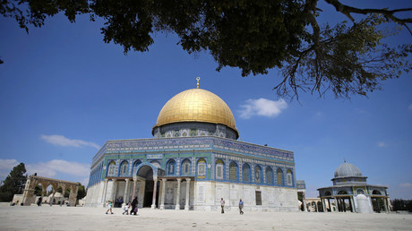 People walk past the Dome of the Rock on the compound known to Muslims as Noble Sanctuary and to Jews as Temple Mount in Jerusalem's Old City September 14, 2014. © Ammar Awad