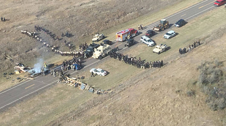 Protesters against the Dakota Access Pipeline stand-off with police in this aerial photo of Highway 1806 and County Road 134 near the town of Cannon Ball, North Dakota, U.S., October 27, 2016. © Morton County Sheriff's Office
