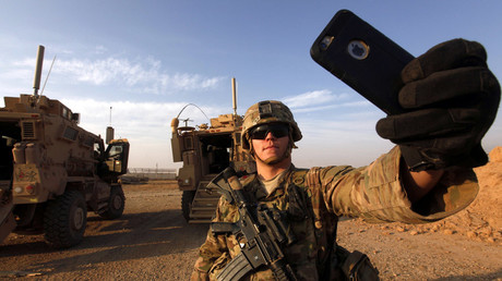 An American soldier takes a selfie at the U.S. army base in Qayyara, south of Mosul October 25, 2016. © Alaa Al-Marjani