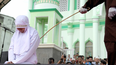 Young Indonesian woman caned for getting 'too close' to her boyfriend