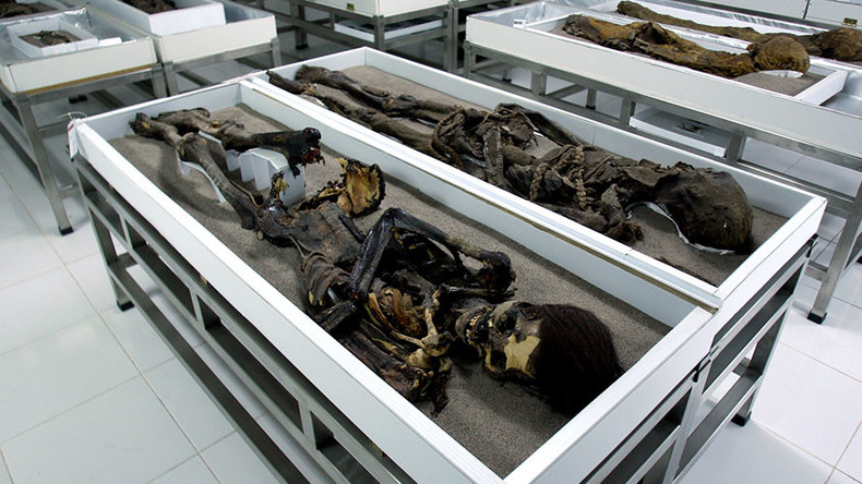 That's a wrap: Ancient mummies slowly 'melting' into black slime (PHOTOS)