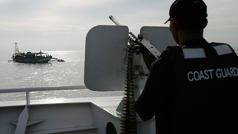 Philippine coast guard enters disputed shoal, China doesn't object
