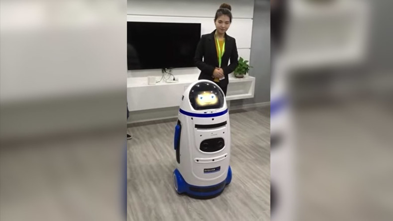 Robots v Humans: AI machine 'attacks' visitor at Chinese tech fair (PHOTOS)