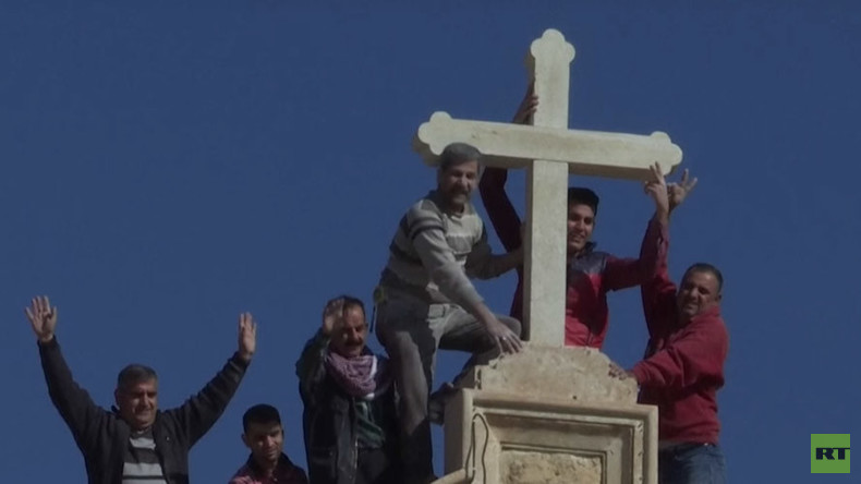 Kurdish militias & locals replace cross destroyed by ISIS atop Christian church near Mosul (VIDEO)