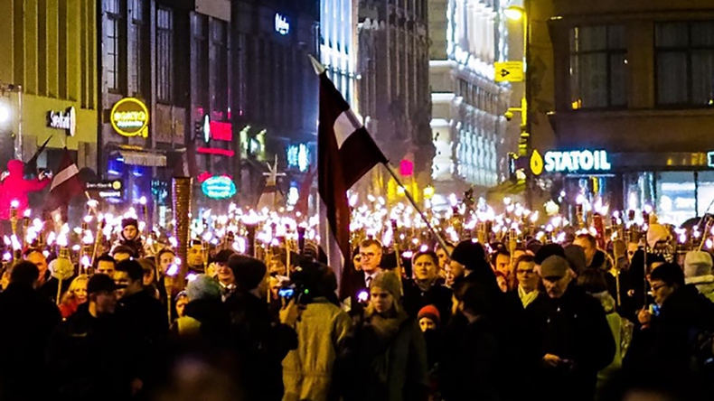 'We are Latvians!' 1,000s join far-right torchlight procession in Riga