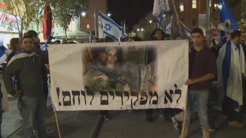 'Free him now!' Protesters demand release of Israeli prisoner charged with killing Palestinian