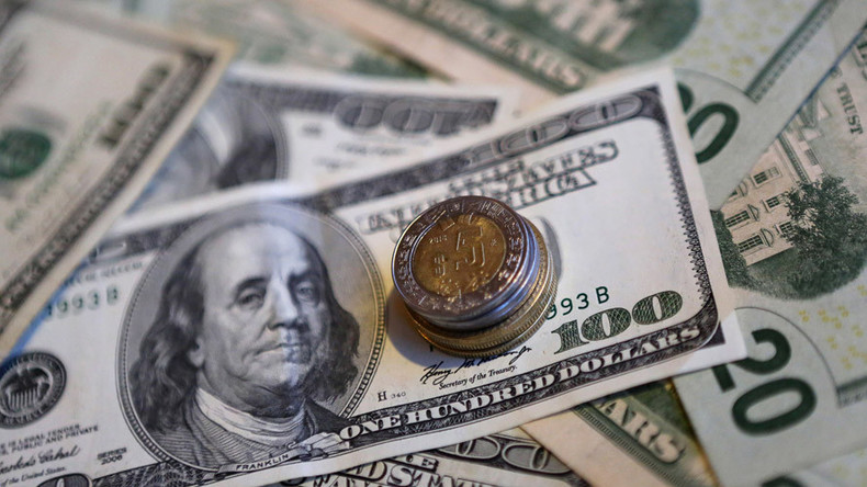 Dollar hovers around 14yr high closing in on parity with euro