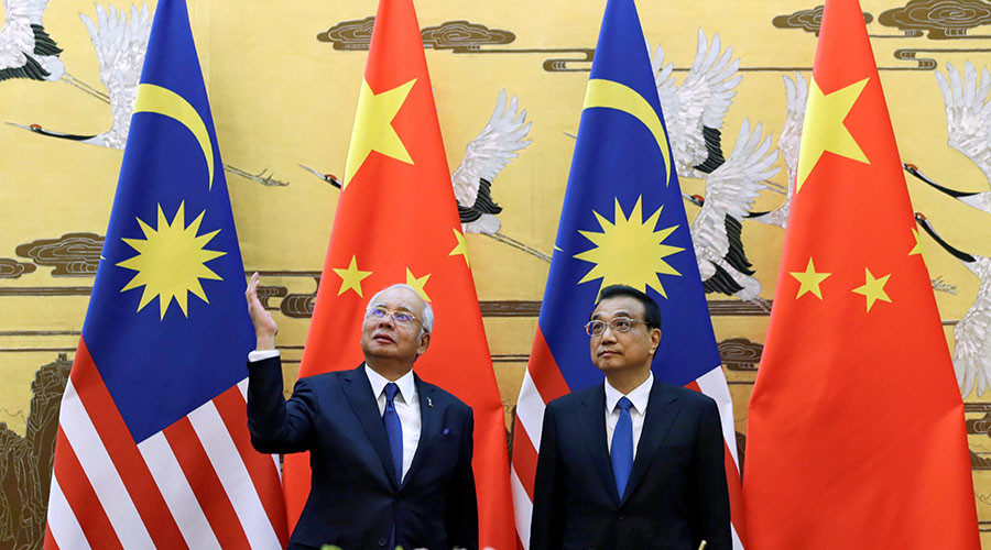 Malaysian PM hits out at 'lecturing ex-colonial powers' amid China visit