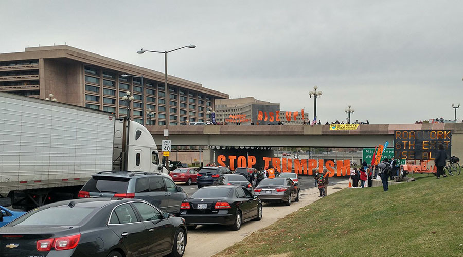 Anti-Trump, anti-TPP protesters block DC highway