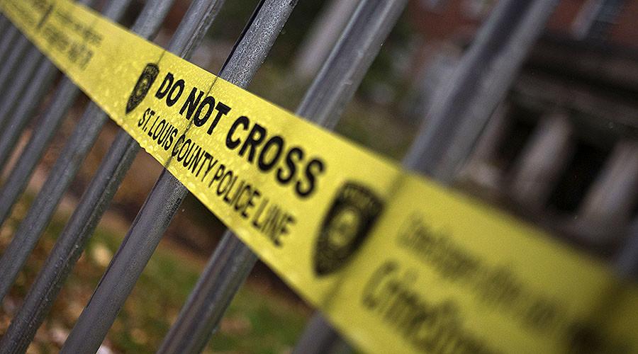 Officer shot 'twice in face' during St. Louis ambush, manhunt underway