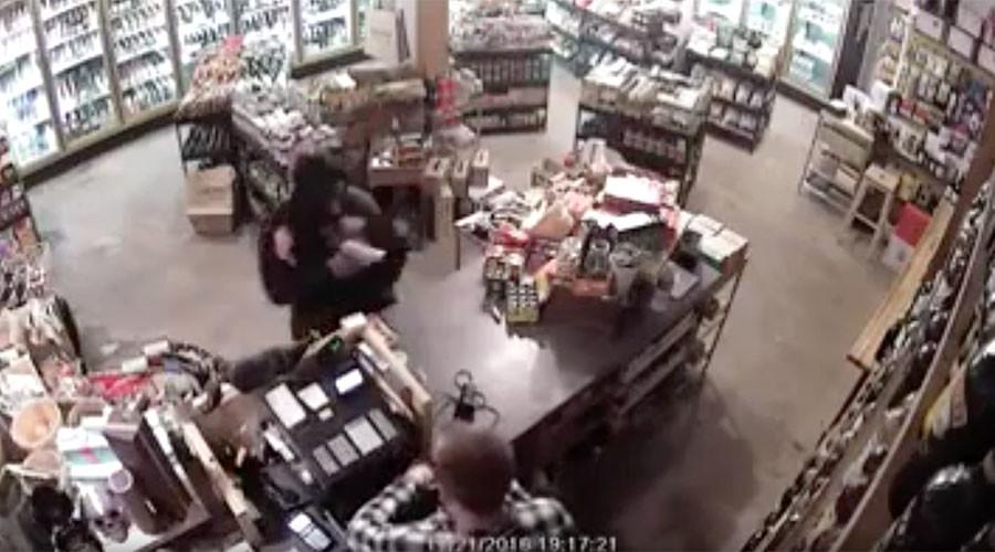 LA shop owner fights off gun-wielding robber (VIDEO)