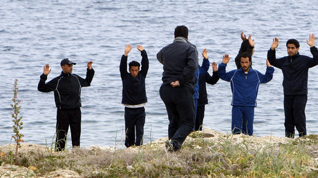 Police stop the refugees, southern Italian island of Lampedusa. File photo. © Antonio Parrinello