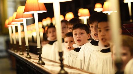 Choristers from St. Paul's Cathedral choir sing at the Quire inside St. Paul's Cathedral in London, Britain. © Dylan Martinez