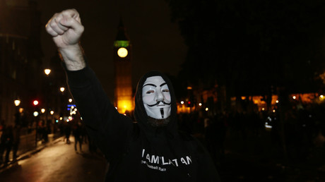 A supporter of the activist group Anonymous gestures during a protest in London, Britain November 5, 2015. © Stefan Wermuth