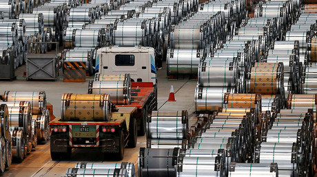 A truck drives past rolls of steel inside the China Steel Corporation factory, in Kaohsiung, southern Taiwan © Tyrone Siu