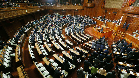 Ruling coalition lawmakers stand to approve the passage of the Trans-Pacific Partnership (TPP) free trade deal in the lower house of the parliament in Tokyo on November 10, 2016. © JiJi PRress