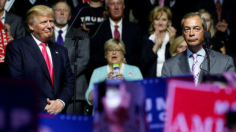 U.S. President-elect Donald Trump  (L) watches as Member of the European Parliament Nigel Farage speaks at a campaign rally in Jackson, Mississippi, U.S., August 24, 2016. © Carlo Allegri