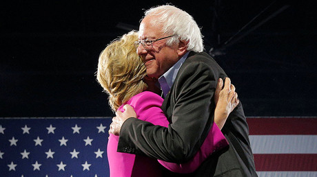 U.S. Democratic presidential nominee Hillary Clinton is hugged by U.S. Senator Bernie Sanders © Brian Snyder