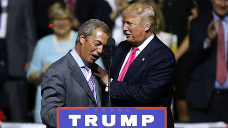 This file photo taken on August 24, 2016 shows Republican Presidential nominee Donald Trump, right, greeting United Kingdom Independence Party leader Nigel Farage, left, during a campaign rally at the Mississippi Coliseum on August 24, 2016 in Jackson, Mississippi. © Jonathan Bachman