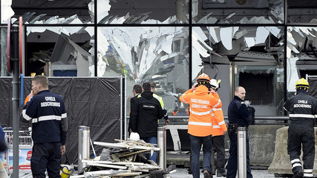 Broken windows of the terminal at Brussels national airport are seen during a ceremony following bomb attacks in Brussels metro and Belgium's National airport of Zaventem, Belgium, March 23, 2016. © Yorick Jansens