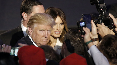 U.S. President-elect Donald Trump and his wife Melania greet supporters during his election night rally in Manhattan, New York, U.S., November 9, 2016. © Mike Segar