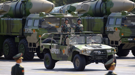 Military vehicles carrying DF-21D ballistic missiles roll to Tiananmen Square © Damir Sagolj