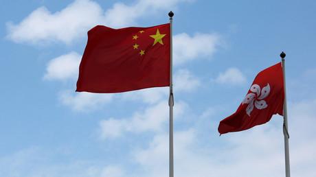 A Chinese national flag and a Hong Kong flag © Bobby Yip