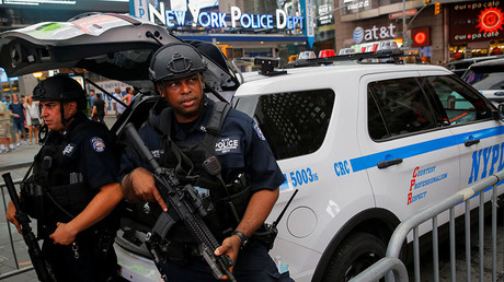 Members of the New York Police Department's Counterterrorism Bureau monitor Times Square in Manhattan, New York. © Andrew Kelly