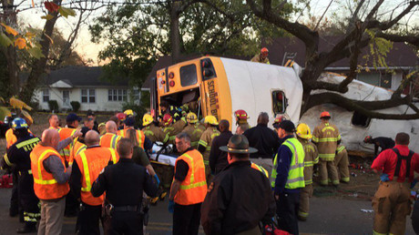 1 killed, several injured when bus with children plunges into 50-foot Alabama ravine