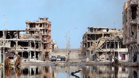 FILE PHOTO: A view of a street in the devastated area where former Libyan leader Muammar Gaddafi was hiding out in Sirte October 22, 2011 © Thaier al-Sudani