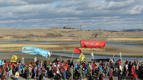 Protesters march along a road during a protest against plans to pass the Dakota Access pipeline near the Standing Rock Indian Reservation, near Cannon Ball, North Dakota, U.S. November 18, 2016. © Stephanie Keith