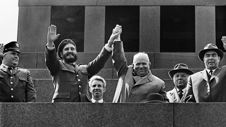 Cuban leader Fidel Castro and Chairman of the USSR Council of Ministers Nikita Khrushchev at the rostrum of the Lenin Mausoleum. Next to them: Kliment Voroshilov and Leonid Brezhnev. Moscow, 1963 © Anatoliy Garanin