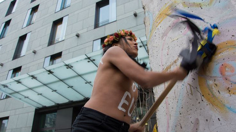 FEMEN activist stages protest outside German Embassy in Kiev, Ukraine © femen.org