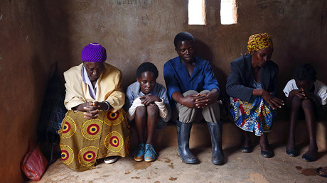 HIV-positive members of a self-help group pray at the start of a meeting in the village of Michelo, south of the Chikuni Mission in the south of Zambia. © Darrin Zammit
