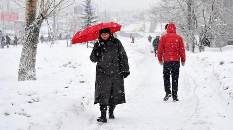 Pedestrians during a snowfalls, Russia. © Vladimir Pesnya