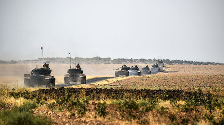 FILE PHOTO: Turkish Army tanks driving to the Syrian Turkish border town of Jarabulus. © Bulent Kilic