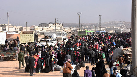 Syrians that evacuated the eastern districts of Aleppo gather to board buses, in a government held area in Aleppo, Syria in this handout picture provided by SANA on November 29, 2016. © SANA