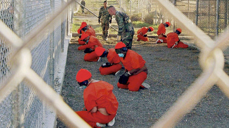 Detainees sit in a holding area during their processing into the temporary detention facility, at Camp X-Ray inside Naval Base Guantanamo Bay. File photo. © U.S. Department of Defense/Petty Officer 1st class Shane T. McCoy / Handout