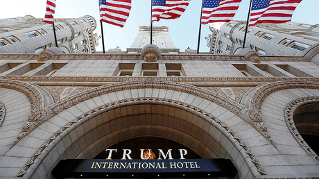 Flags fly above the entrance to the new Trump International Hotel on its opening day in Washington September 12, 2016. © Kevin Lamarque
