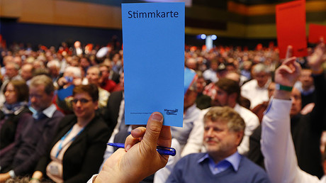 AfD party members hold voting cards during the AfD party congress in Stuttgart, Germany, April 30, 2016. © Wolfgang Rattay
