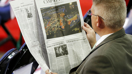 A man reads The Washington Post © Mike Segar